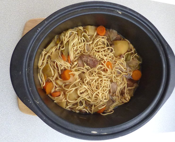 cooked goat stew with noodles