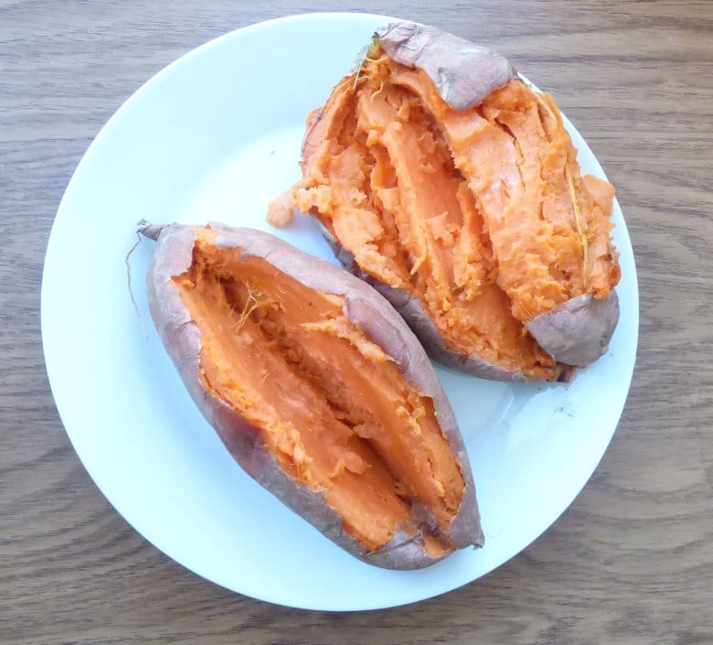 baked sweet potatoes with skins sliced open