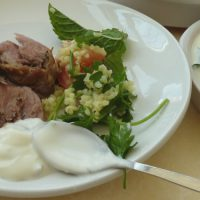 Slow cooker roast lamb with spices, served with tabbouleh and minted yogurt from busylizziecooks.com
