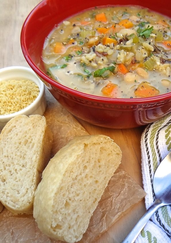 Bowl of veggie and wild rice soup with bread