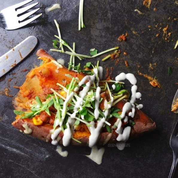 Sweet potato stuffed with korma, drizzled with dressing
