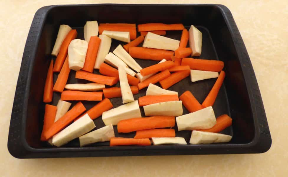Tray of chopped carrots and parsnips ready to roast