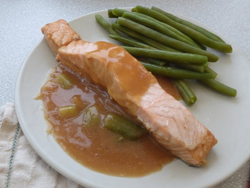 plated salmon with miso sauce and green beans