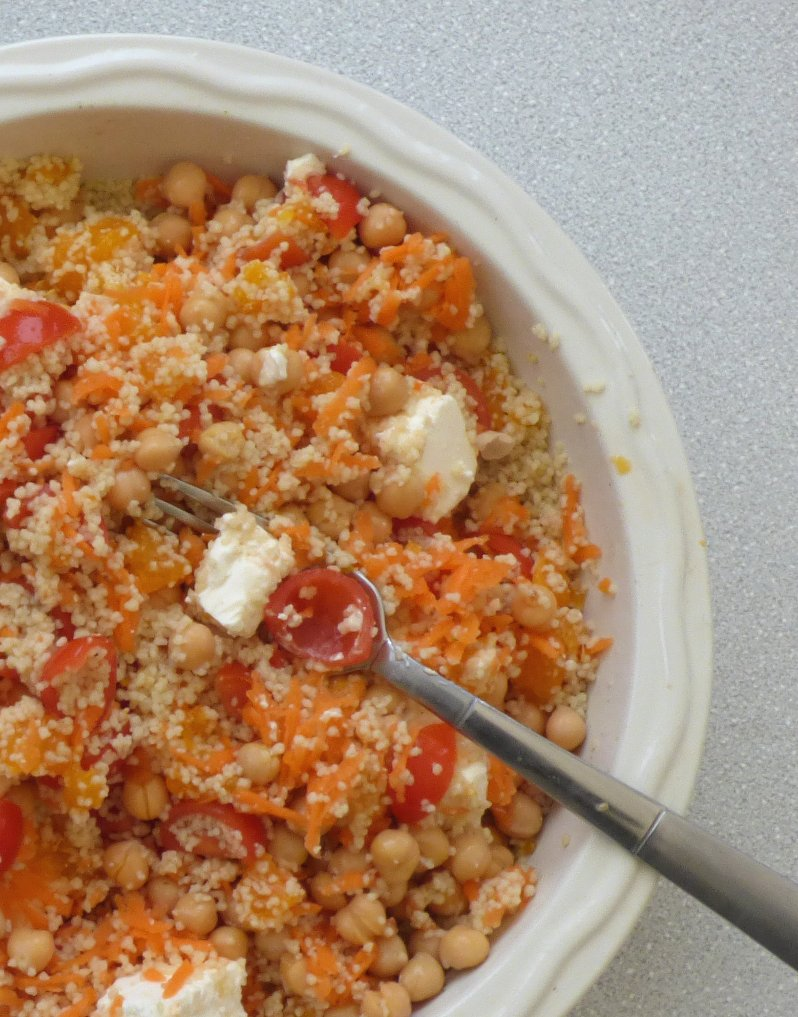 serving bowl of couscous salad with feta