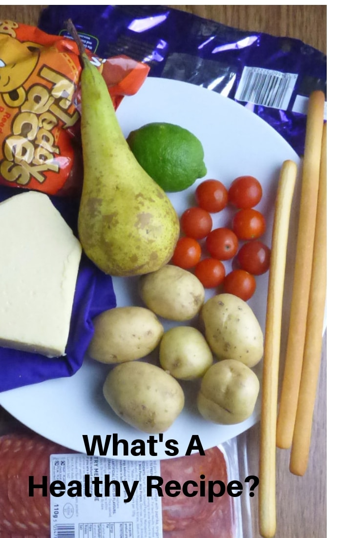 Text 'What's a healthy recipe?' with variety of foods in background