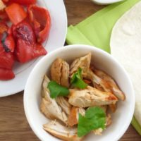 easy shredded chicken with lime and paprika in dish as part of taco buffet