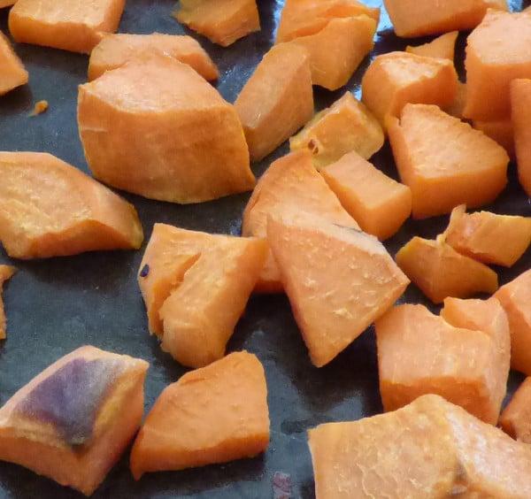 Maple roasted sweet potatoes on baking sheet