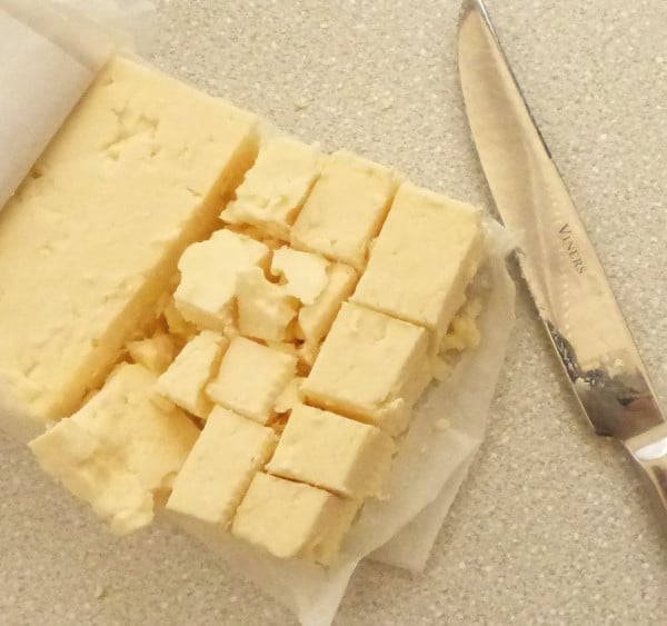 packet of partially cubed Wensleydale cheese with knife