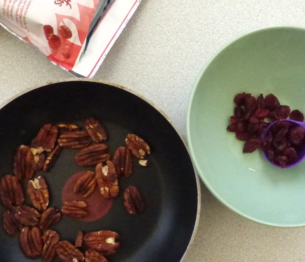 pan of toasted pecans, bowl of cranberries